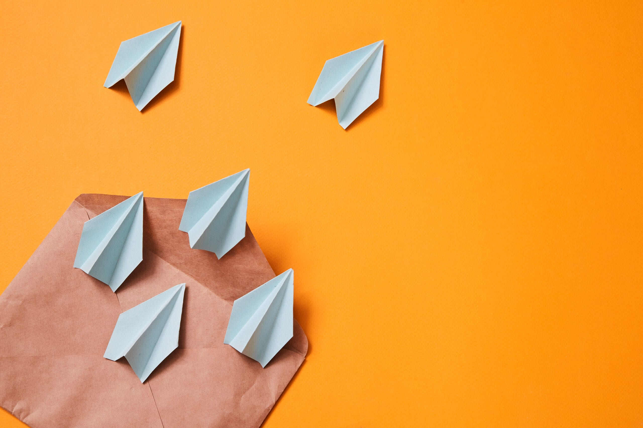 Concept for sending e-mails and e-commerce business. Email marketing. Paper planes flying out of the envelope.