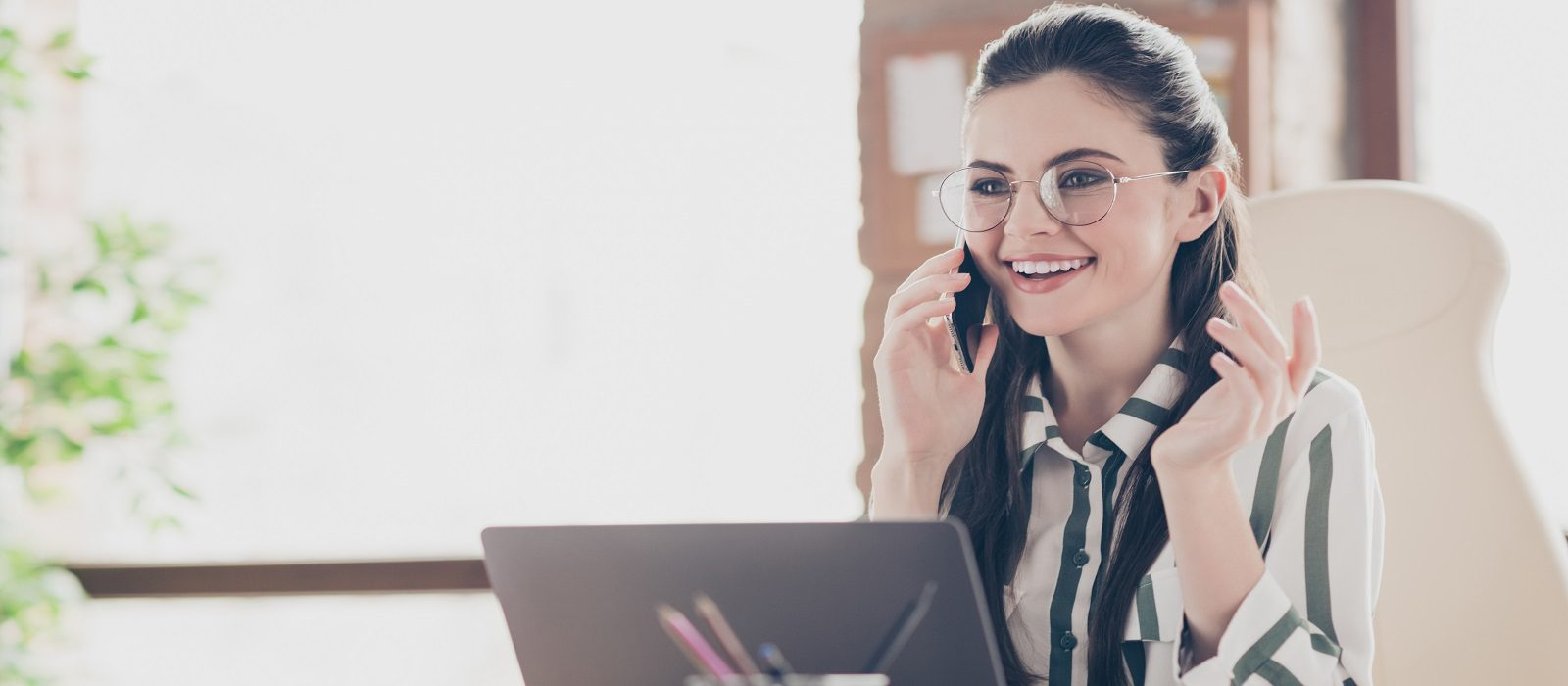 Close-up portrait of her she nice attractive smart clever cheerful cheery girl leader partner company founder talking on phone at modern brick, loft industrial interior style workplace workstation